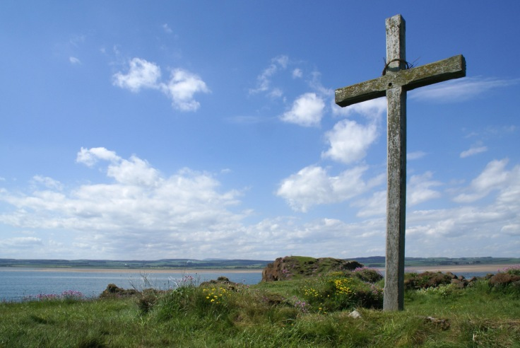 Picture of a wooden Christian cross on St. Cuthbert's Isle, Holy Island, Northumberland. St Cuthbert's Isle is a small island used as a retreat by both Aidan and Cuthbert.